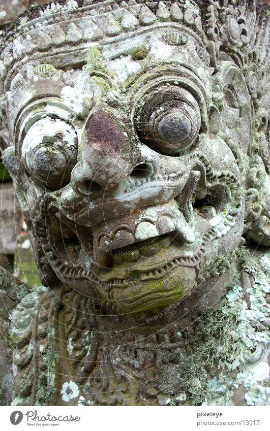 temple guards Bali Statue Face stone face