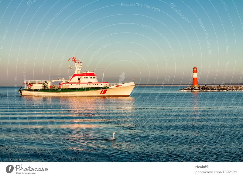 Mole and ship in Warnemünde Vacation & Travel Winter Water Coast Baltic Sea Ocean Tower Lighthouse Manmade structures Tourist Attraction Landmark Watercraft