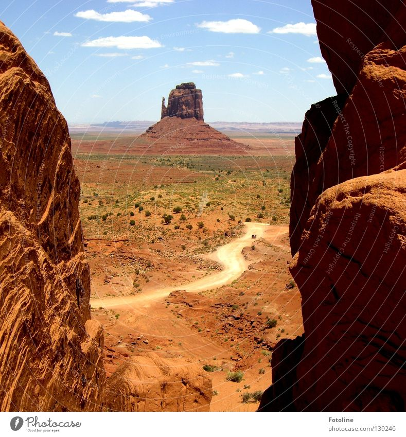 Monument Valley Clouds White Brown Plant Loneliness Americas USA mountain Lanes & trails Desert Stone Sky Blue Shadow