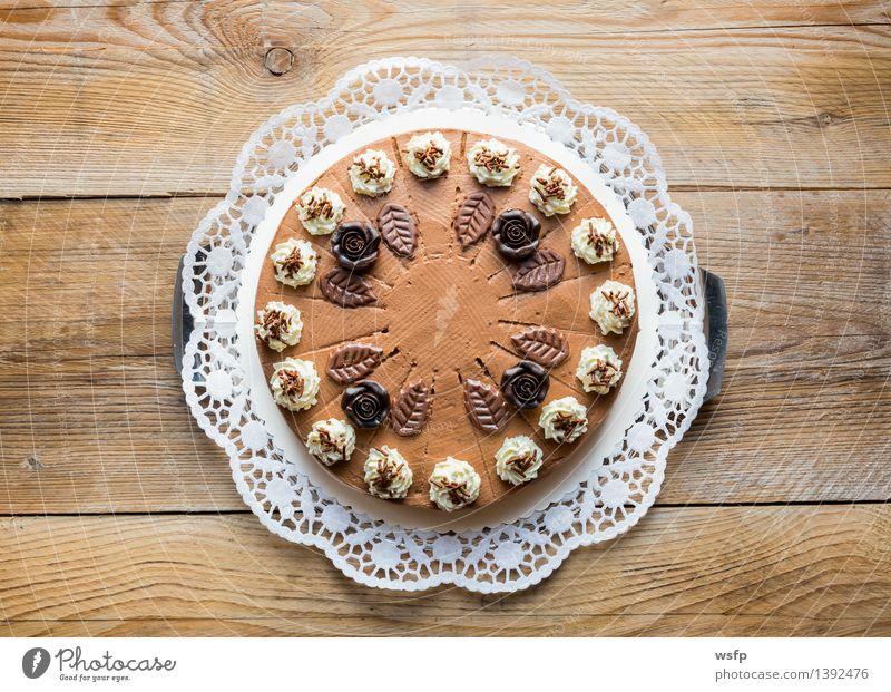 Chocolate cream cake on rustic wood with cake lace Cake Dessert Wood Sweet chocolate cream cake Gateau foam pastries Cream cake top Baked goods sponge cake