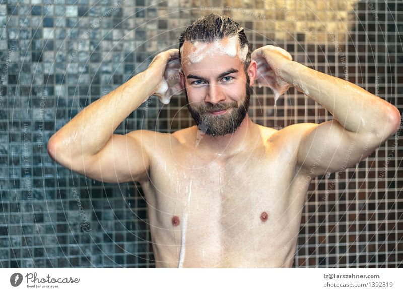 Bearded man washing his hair Lifestyle Personal hygiene Skin Health care Medical treatment Bathroom Man Adults Hair Smiling Friendliness Naked Clean at camera