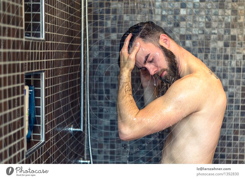 Young bearded man washing his hair Personal hygiene Health care Bathroom Man Adults Beard Hair Naked Clean bathing cleanliness closed Copy Space cubicle eyes