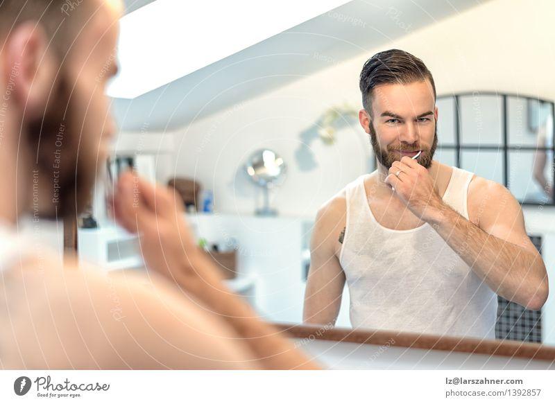 Bearded man brushing teeth in bathroom Face Health care Mirror Bathroom Man Adults Teeth Toothbrush Modern Clean caries cleaning cleanliness Dental Dentistry