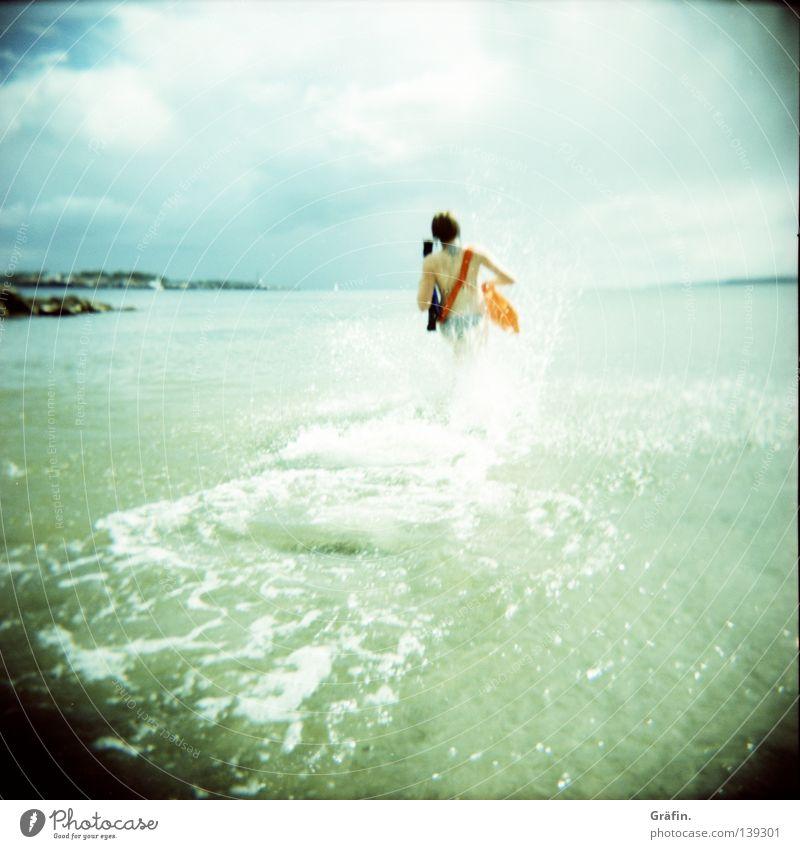 Water Sun Ocean Beach Clouds Far-off places Cold Playing Coast Lake Horizon Waves Swimming & Bathing Walking Running Dangerous