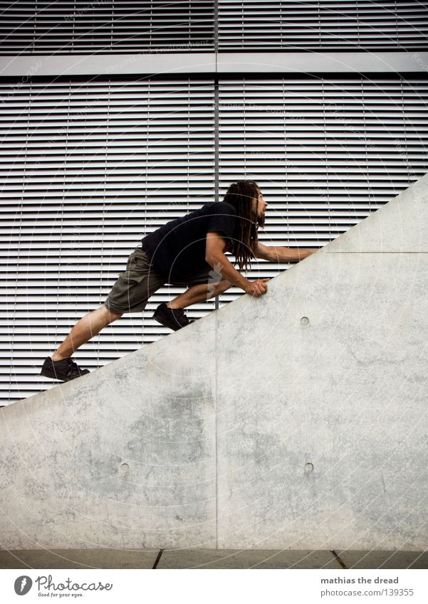 BLN 08   PROMOTION Young man Climbing Parkour Facade Venetian blinds Concrete Concrete wall Concrete construction Architecture Upward Aspire Diagonal Queer fish