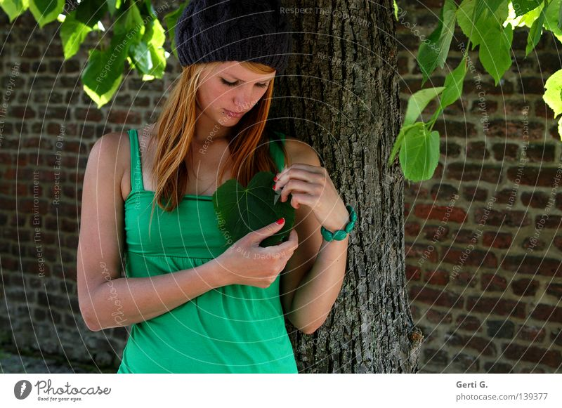 Woman Nature Youth (Young adults) Green Beautiful Tree Red Leaf Adults Face Love Young woman Wall (building) Wall (barrier) Stone Heart