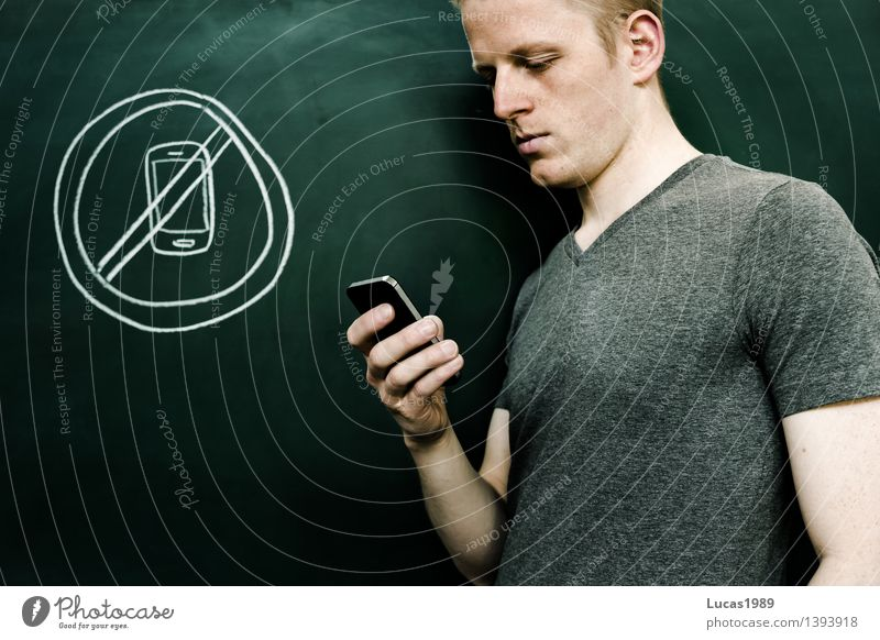 young man uses smartphone, not allowed Education School Study Classroom Blackboard schuler Teacher Academic studies University & College student Lecture hall
