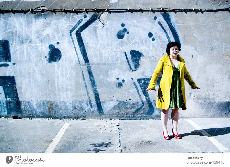 Jump! Coat High heels Woman Going Wall (building) Wall (barrier) Concrete Red Black Yellow Green Neon light Style Self-confident Turnaround Clothing Walking