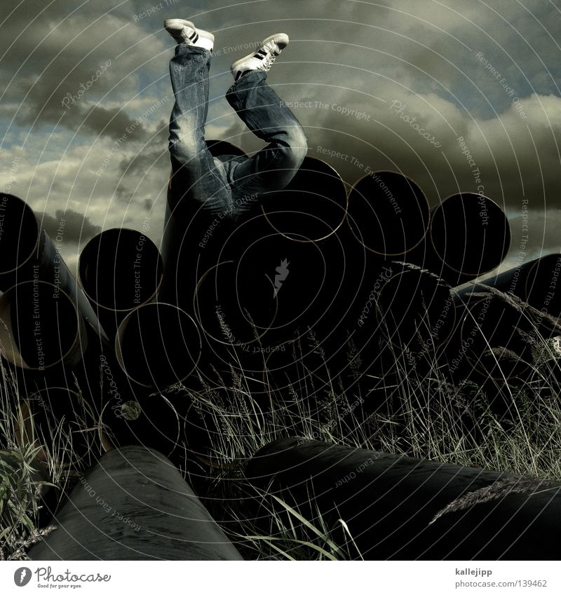 Human being Man Sky Clouds Grass Feet Footwear Legs Jeans Peace Construction site Pants Pipe Obscure Past Hollow