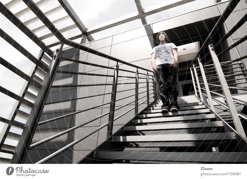 foreign bodies Steel Cold Muddled Chaos Agitated Man Respirator mask Crazy Motionless Glittering Light Handrail Stairs Modern linkage Sky Human being Mask Jeans