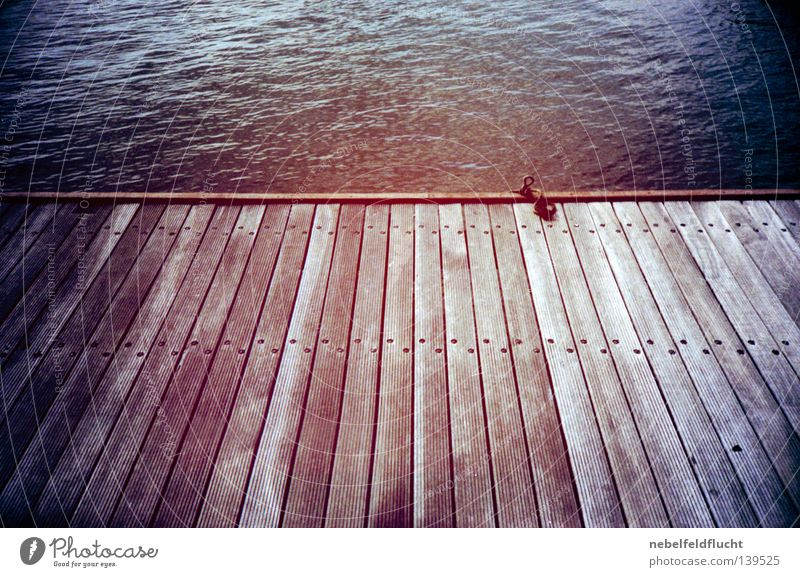 footbridge Footbridge Wood Wooden board Ocean Lake Summer Watercraft Drop anchor Anchor Moody Vacation & Travel Red Retro Cold Physics Lomography Vignetting