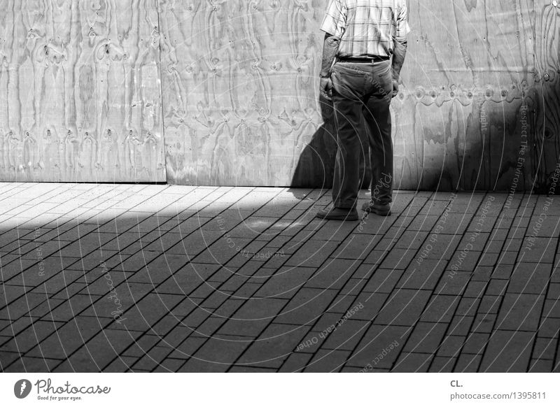 A man stands in front of a wall. Human being Masculine Man Adults Life 1 45 - 60 years Summer Beautiful weather Wall (barrier) Wall (building) Stand Loneliness