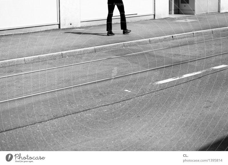 Human being Man City Adults Street Life Movement Lanes & trails Legs Going Masculine Transport Traffic infrastructure Pedestrian Road traffic Tram