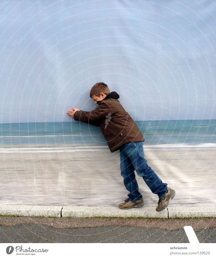 dry float Ocean Dry Small Really Make believe Speed Humor Exterior shot Portrait photograph Spontaneous Playing Blue Boy (child) Swimming & Bathing