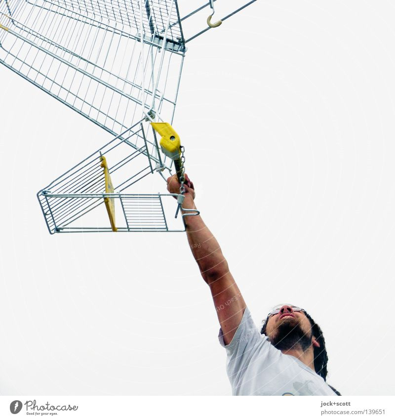 König Kunde lifts his shopping trolley deal Services Man Adults 1 Human being Shopping Trolley Beard Dreadlocks Cool (slang) Above Emotions Force Willpower