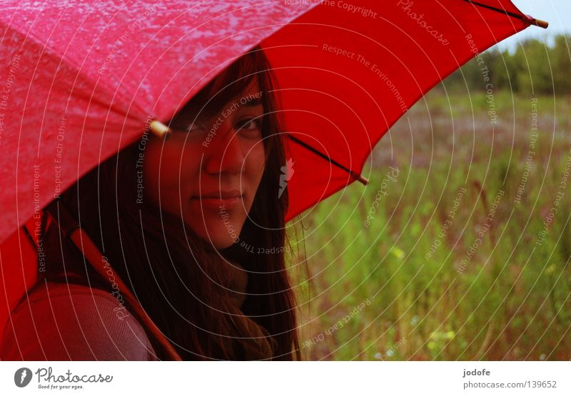 Woman Human being Youth (Young adults) Green Red Face Cold Meadow Feminine Autumn Grass Spring Hair and hairstyles Rain Weather Wet