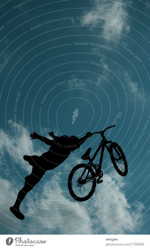Superman Bicycle Jump Trick Stunt Shows Clouds Man Motorcyclist Mountain bike Reckless Risk Air Stand Dangerous Turquoise Summer Bird Black Progress Practice