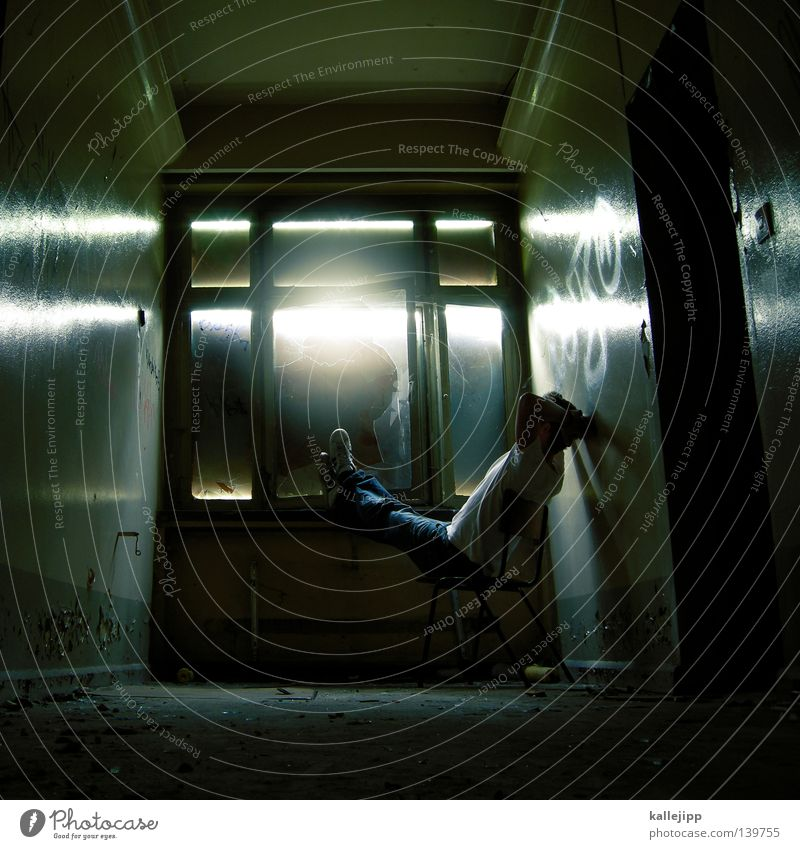 Human being Man Sun Relaxation Dark Window Freedom Fear Sit Chair Hallway Laws and Regulations Panic Penitentiary Criminality Beam of light