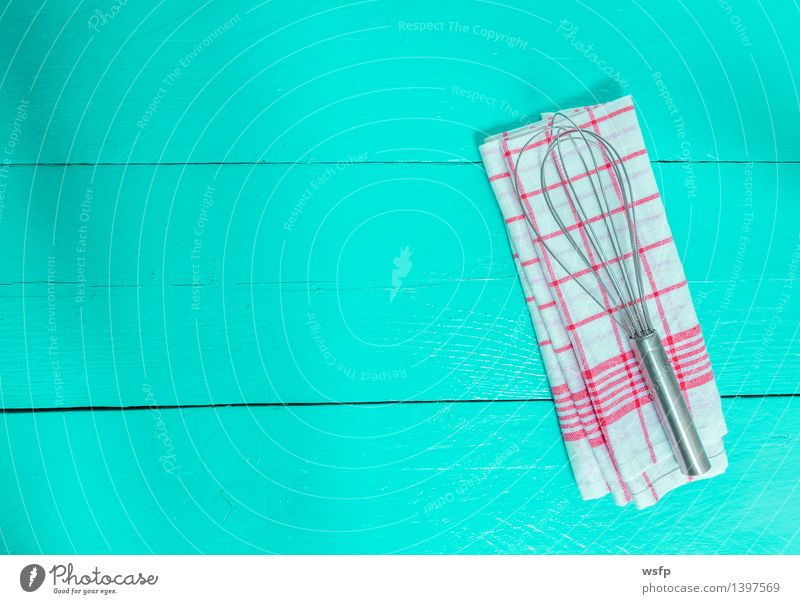 Whisk and tea towel on turquoise wood background Kitchen Restaurant Gastronomy Old Red Turquoise White Beater Dish towel kitchen towel Wooden board Wooden table
