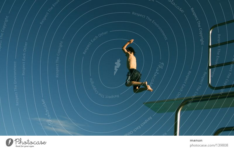 Human being Sky Youth (Young adults) White Blue Summer Joy Clouds Black Sports Freedom Jump Movement Warmth Air Healthy
