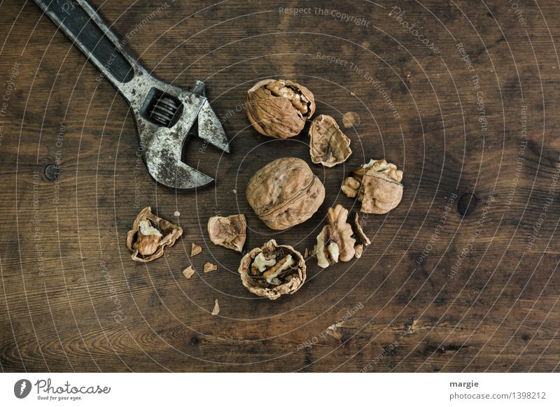 Brute force: closed and opened walnuts with a wrench Nutrition Leisure and hobbies Christmas & Advent Tool Technology Nutcrackers Nutshell Walnut Wood Metal