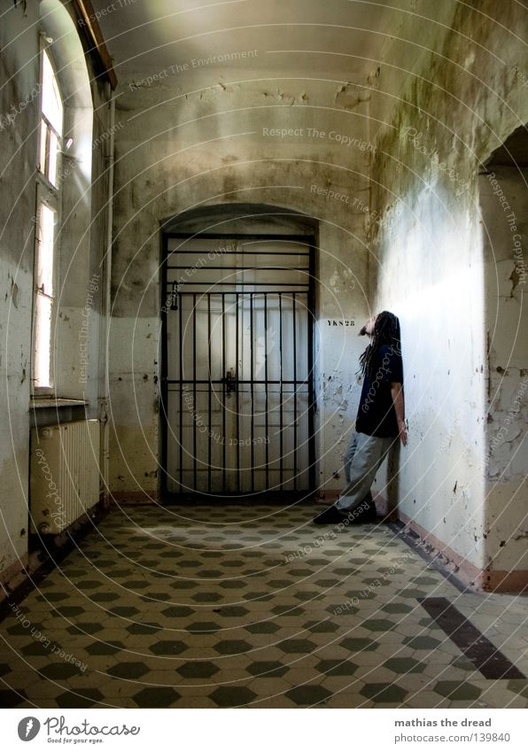 ray of hope Hallway Gate Grating 1 Person Individual Isolated (Position) Loneliness Captured Convict Penitentiary One young adult man Only one man Boredom