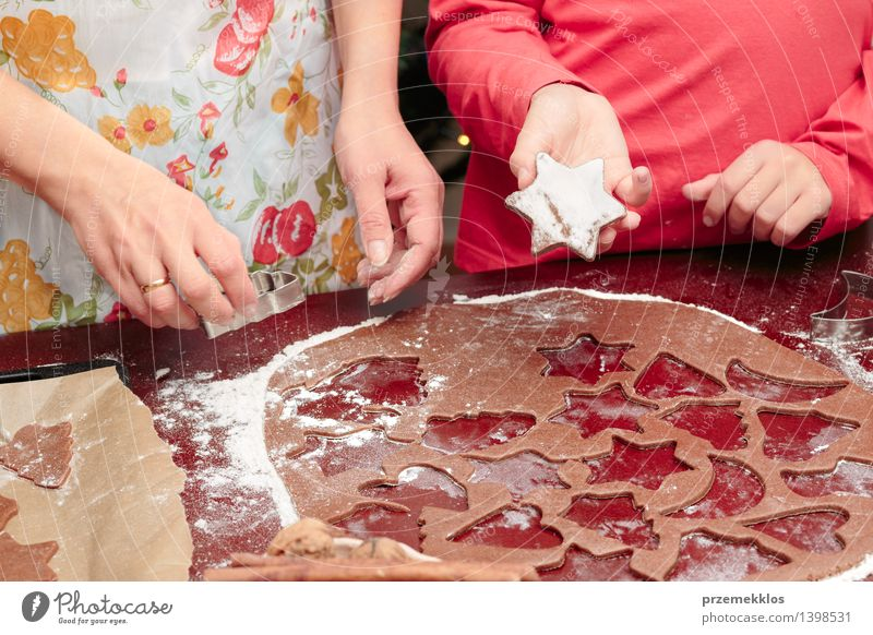 Cutting out the Christmas symbols in the dough for the cookies Human being Woman Child Christmas & Advent Hand Red Girl Adults Feasts & Celebrations Infancy