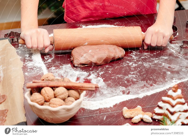 Girl making dough for a Christmas cookies Table Kitchen Human being Hand 1 8 - 13 years Child Infancy Make Flour Gingerbread Home-made knead Preparation