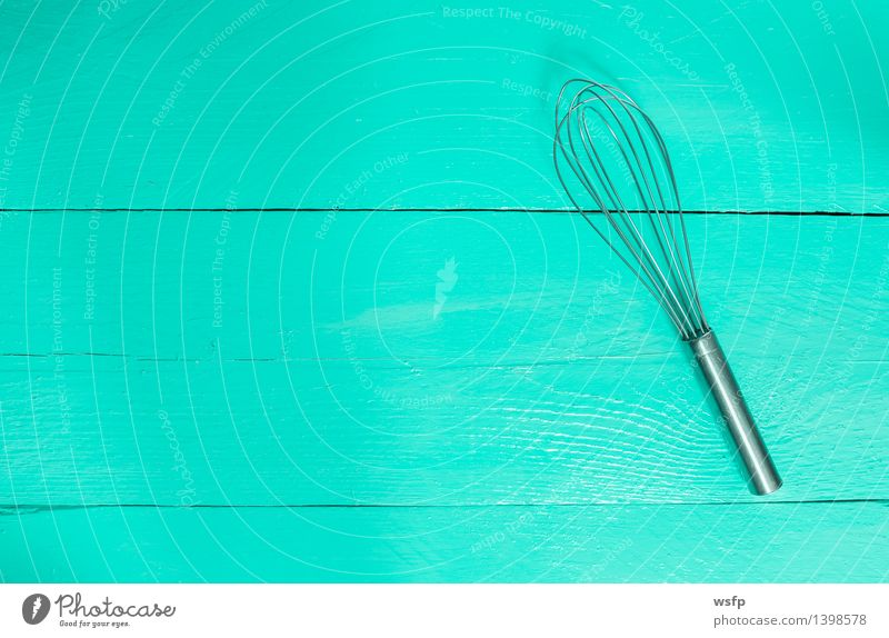 Whisk on turquoise wood as background Kitchen Restaurant Gastronomy Old Turquoise Beater Wooden board Wooden table Wooden sign wooden background boards Menu