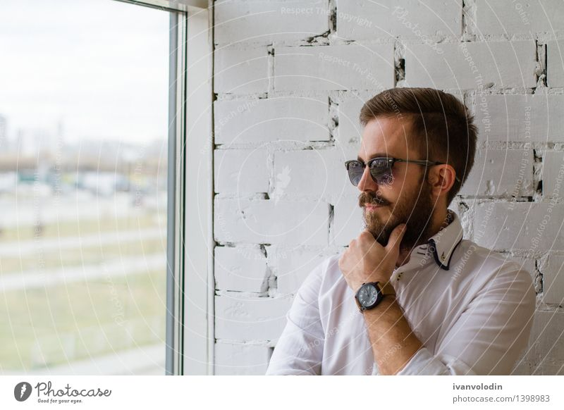 Bearded man in sunglasses looking at the window Lifestyle Elegant Style Hair and hairstyles Face Human being Masculine Man Adults Fashion Shirt Sunglasses