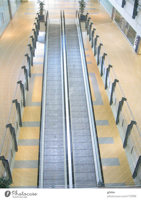 3 floor view Escalator Moving pavement Yellow White Architecture Handrail Above Metal