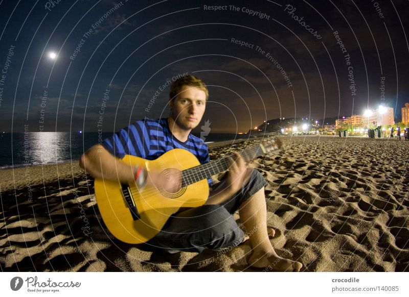 guitar hero Guitar Man Sand Beach Playing Music Make music Musician Artistically talented Moon Long exposure Spain Night Ocean Reflection Legs Pants Jeans Sit