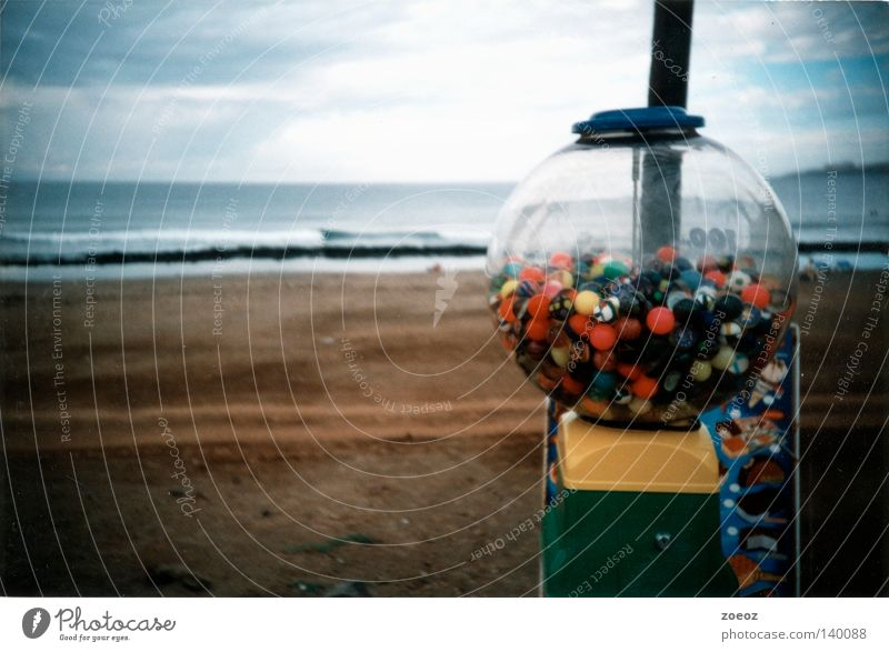 chewing gum strand Beach Promenade Candy Vacation & Travel Bad weather Gumball machine Ocean Earth Sand Lomography Clouds Multicoloured