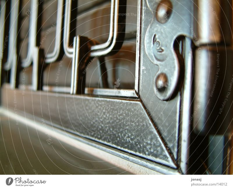 Section of image Partially visible Heating by stove Hinge Metal fitting Metal grid Wrought iron Wrought ironwork