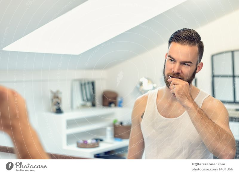 Bearded man brushing his teeth Face Health care Mirror Bathroom Man Adults Teeth Toothbrush Modern Clean caries cleaning cleanliness Dental Dentistry grooming