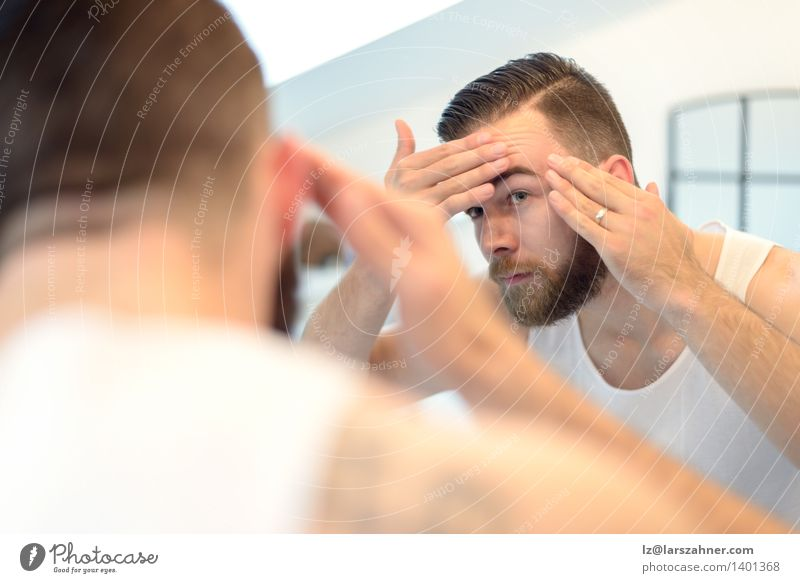 Bearded man checking his complexion Skin Face Mirror Bathroom Man Adults Hand Old Clean appearance cleanliness Complexion Conceptual design concerned Forehead