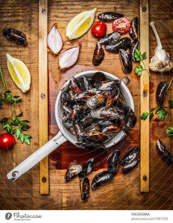 Fresh mussels in an old sieve with ingredients Food Seafood Herbs and spices Nutrition Lunch Dinner Buffet Brunch Banquet Organic produce Vegetarian diet Diet