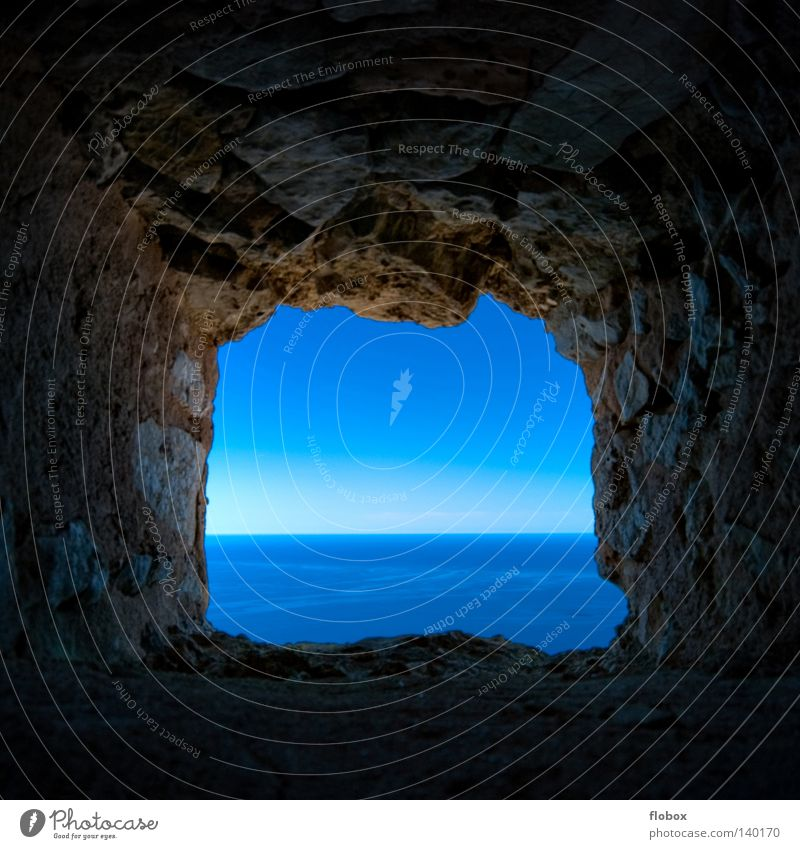 Light at the end of the tunnel... Ocean Vantage point Blue Lake Sky Water Waves Horizon Far-off places Hollow Window Fortress Penitentiary Captured Loneliness