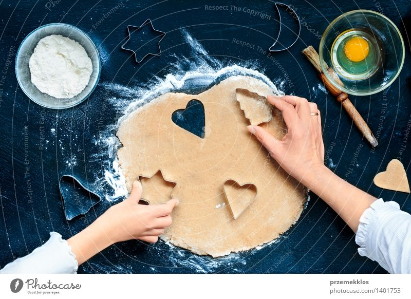 Mom with daughter cutting out the Christmas symbols in the dough Human being Woman Christmas & Advent Hand Girl Adults Feasts & Celebrations Table Heart