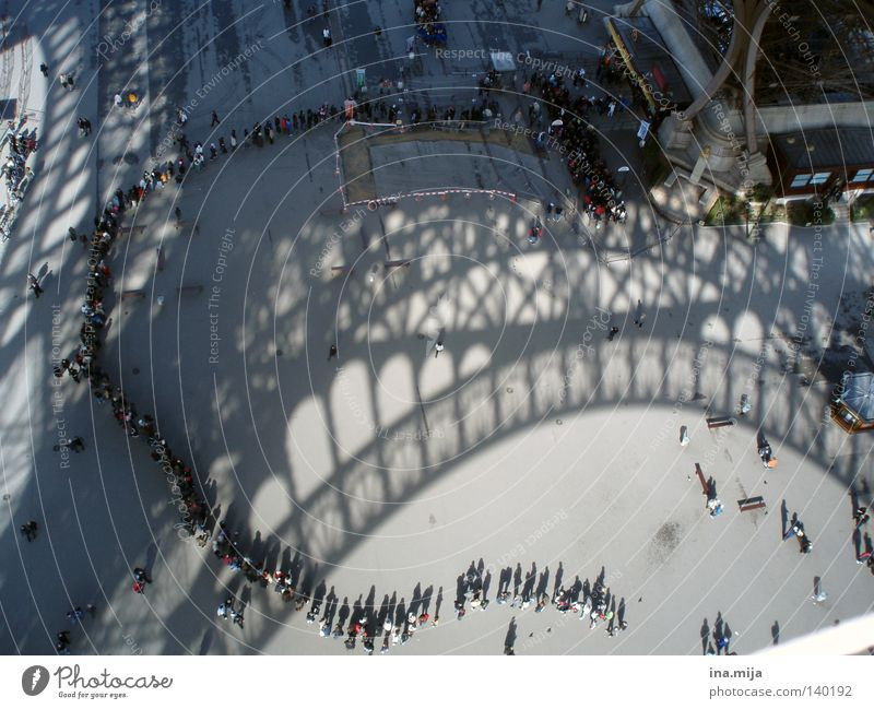 Schatten des Wartens Human being City Vacation & Travel Wait Stand Travel photography Tower Long Paris Monument Crowd of people France Shadow Historic Landmark