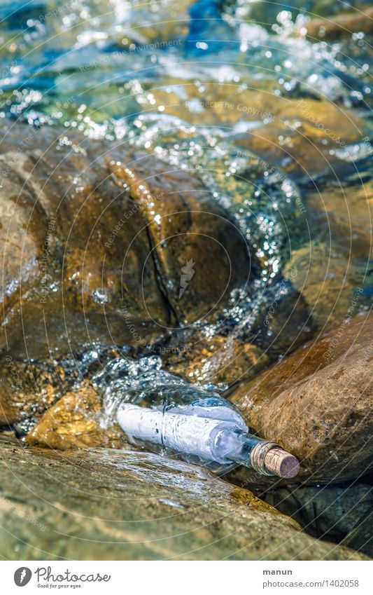 rinse water Nature Water Rock Coast Bay Ocean Message in a bottle Mail Letter (Mail) Piece of paper Packaging Glass Sign Communicate Information Colour photo