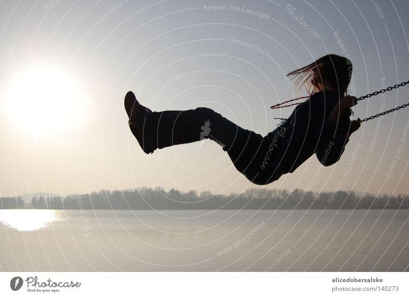 Human being Sky Water Sun Joy Black Dark Hair and hairstyles Laughter Lake Wind Tall Near Deep Chain Swing