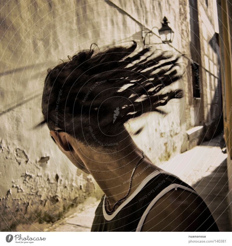 Movement Human being Man Youth (Young adults) Head Dreadlocks Shake of the head Looking back Rotate Swing Spirited Alley Exterior shot Faceless Rear view
