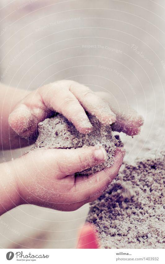 Pattycake - children's hands playing in the sand Parenting Kindergarten Child Toddler Hand Fingers Children`s hand Sand Playing Cute Sandpit Sand cake