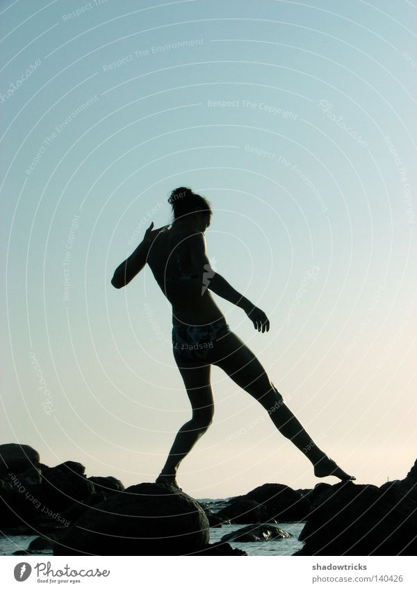 Human being Woman Sky Blue Water Black Adults Dark Movement Stone Earth Style Legs Air Dream Feet