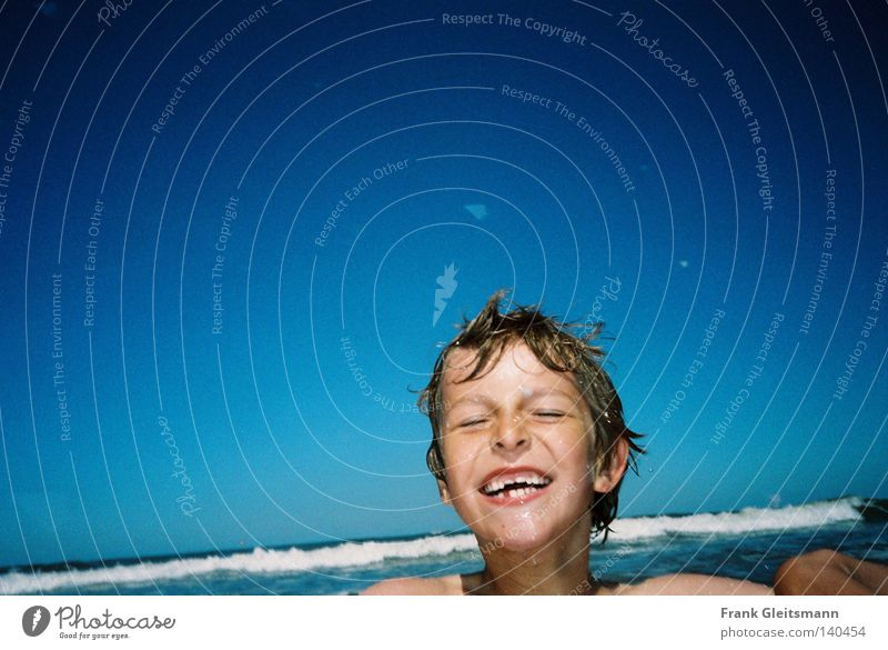 joy Joy Ocean Blue Vacation & Travel Boy (child) Laughter Child Waves Wet Cold North Sea Happy Beautiful weather Dazzling white teeth Swimming & Bathing White