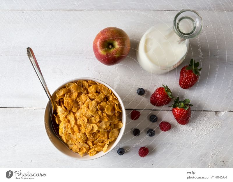 Cornflakes in a bowl Fruit Apple Breakfast Milk Bowl Wood breakfast cereals Flake Blueberry Cereals raspberry Strawberry Grain Eating shell Bright background
