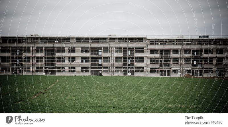 Sky Dark Meadow Grass Large Lawn Construction site Material Construction worker Panorama (Format) Scaffold Settlement New building Incomplete Scaffolder