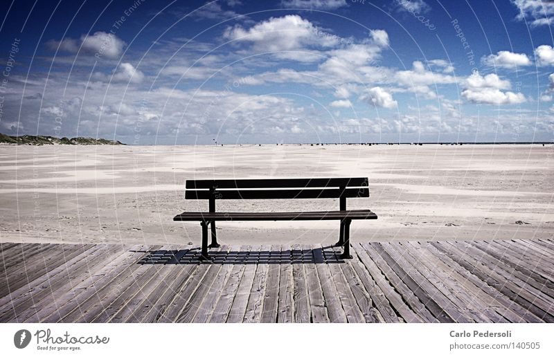 sandbank Bench Empty Loneliness Far-off places Wood Old Weathered Footbridge Beach Sand Ocean Coast Beach dune Beach chair Sky Clouds Low tide Plank Free
