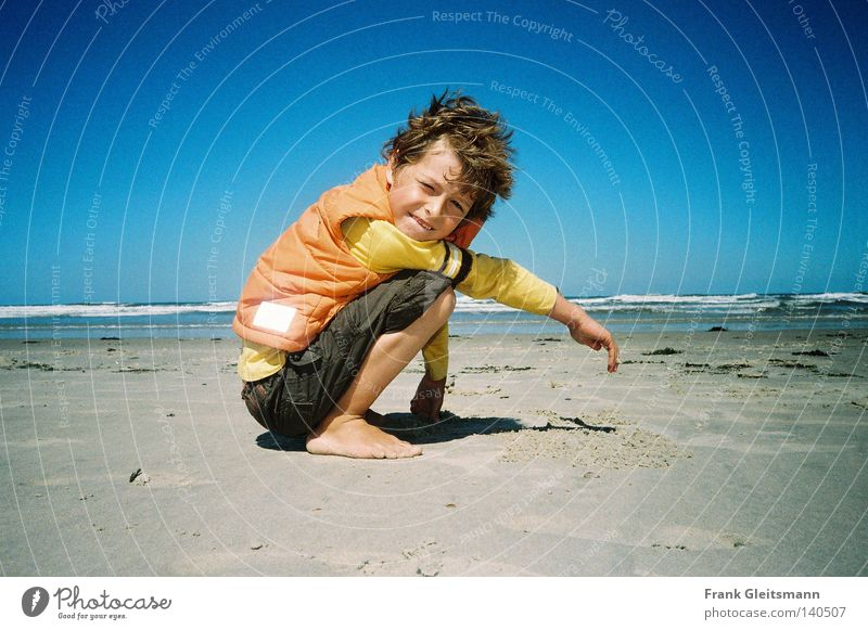 colors Ocean Blue Vacation & Travel Sand Beach Travel photography Boy (child) Laughter Child Gale Wind North Sea Beautiful weather Blue sky Coast Laugh child